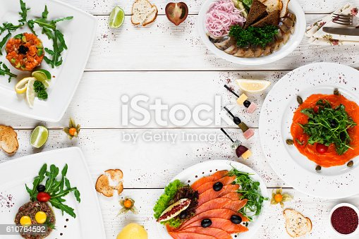 istock Delicious snacks on white table, free space 610764592