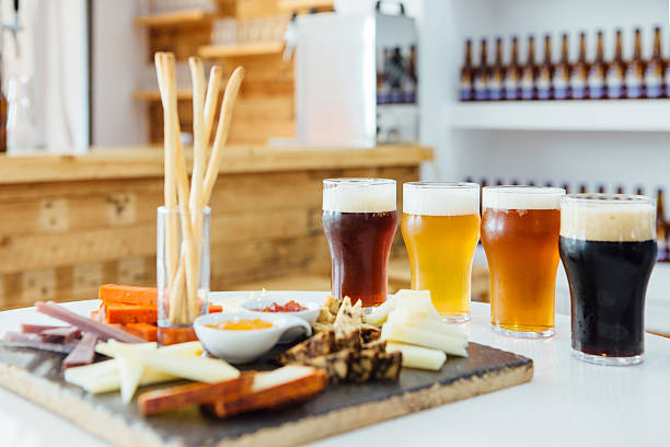Delicious snacks with craft beer stock photo