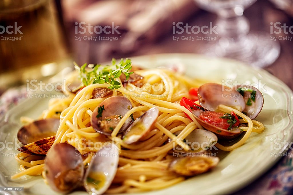 Delicious Spaghetti alla Vongole Served on a Plate royalty-free stock photo