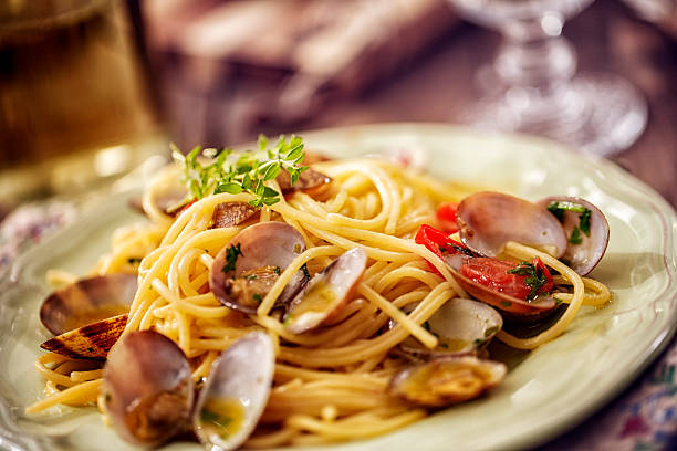delicious spaghetti alla vongole served on a plate - italian food stock photos and pictures