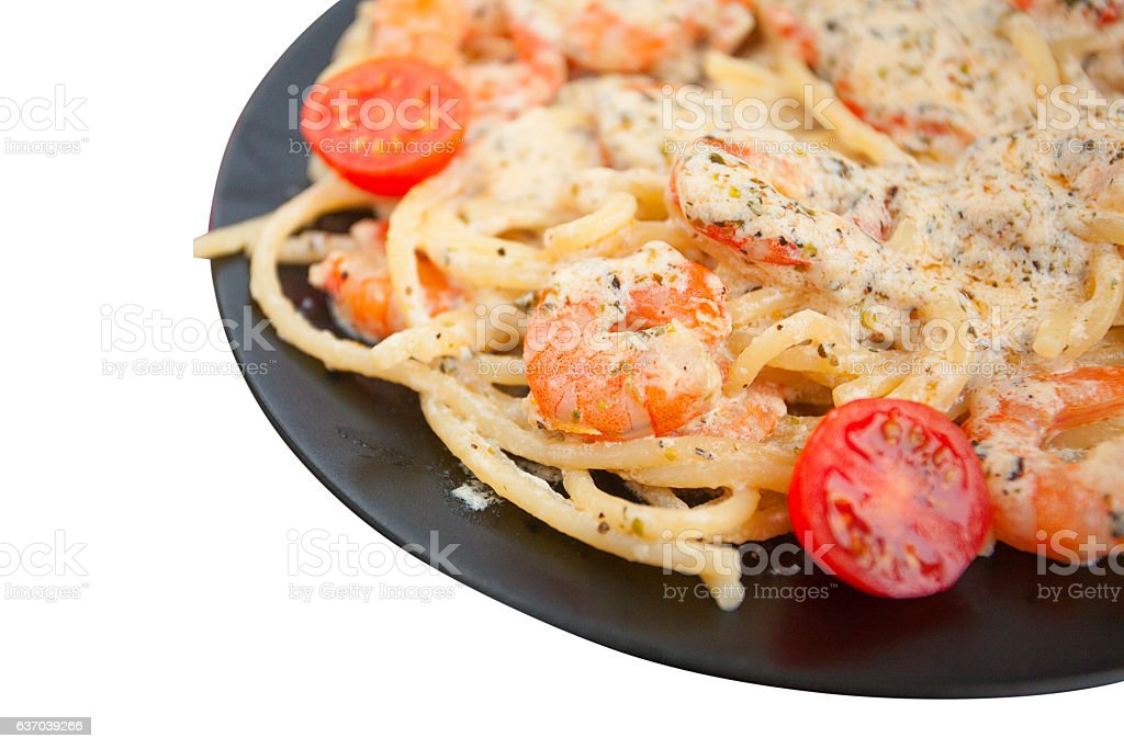 delicious Spaghetti pasta with prawns on black plate stock photo