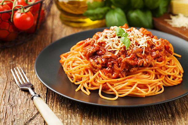 Delicious spaghetti served on a black plate stock photo