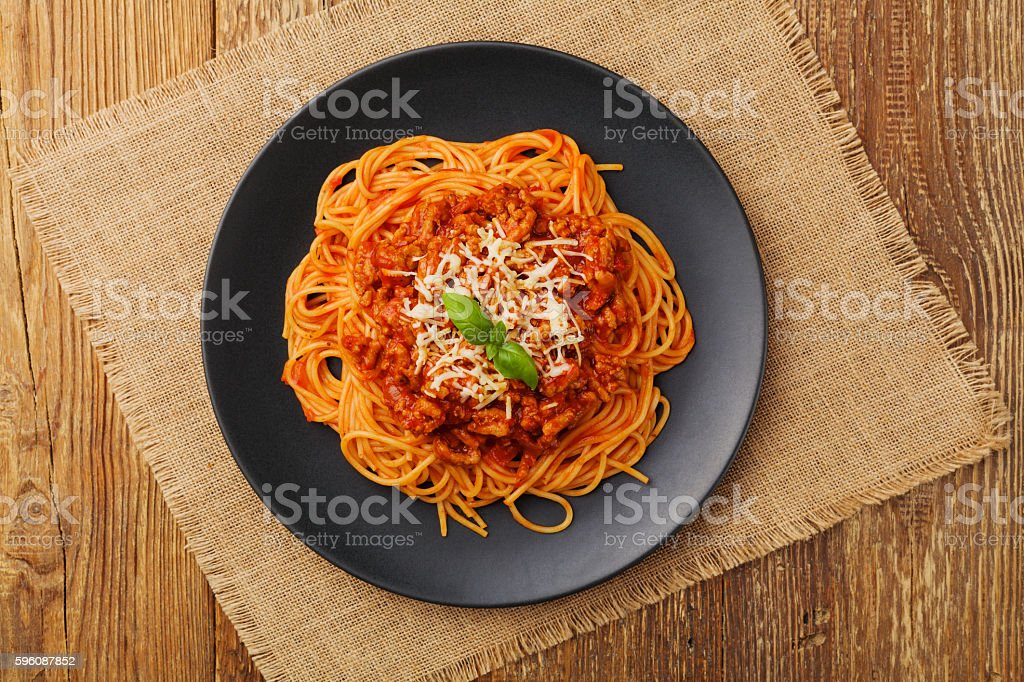 Delicious spaghetti served on a black plate royalty-free stock photo