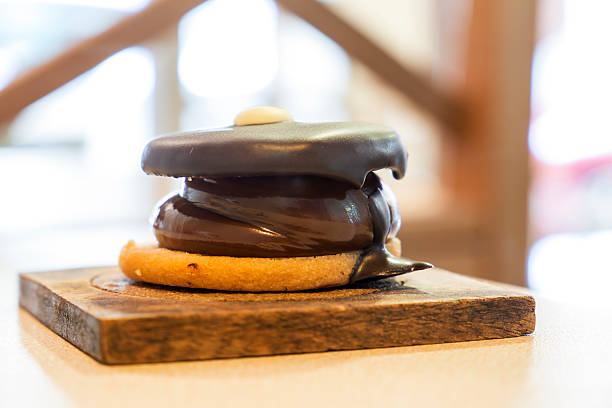 Delicious spanish alfajor cookie clouse-up covered with chocolate - foto de stock