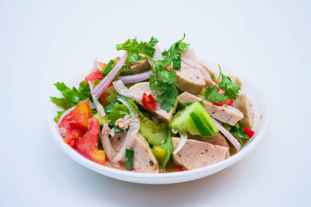 Delicious spicy vietnamese sausage salad with vegetable. stock photo