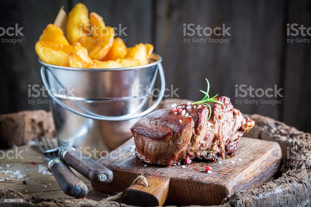 Delicious steak and chips with rosemary and salt stock photo