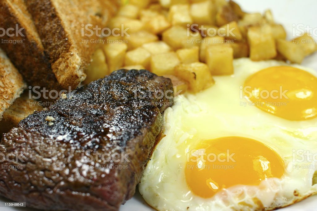 Delicious steak and eggs breakfast stock photo