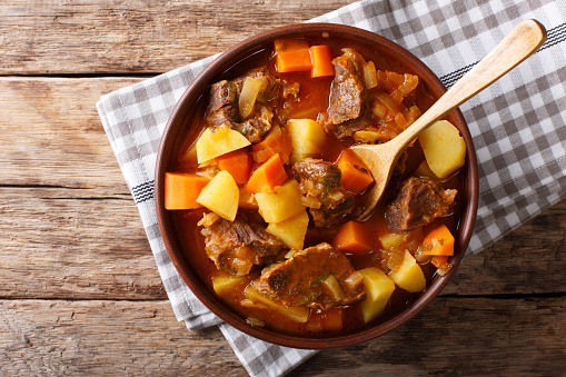 Delicious Stew Estofado With Beef And Vegetables Closeup Horizontal Top View Stock Photo - Download Image Now