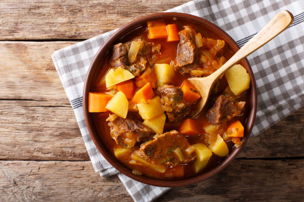 delicious stew estofado with beef and vegetables close-up. Horizontal top view delicious stew estofado with beef and vegetables in a bowl close-up. Horizontal top view from above goulash stock pictures, royalty-free photos & images