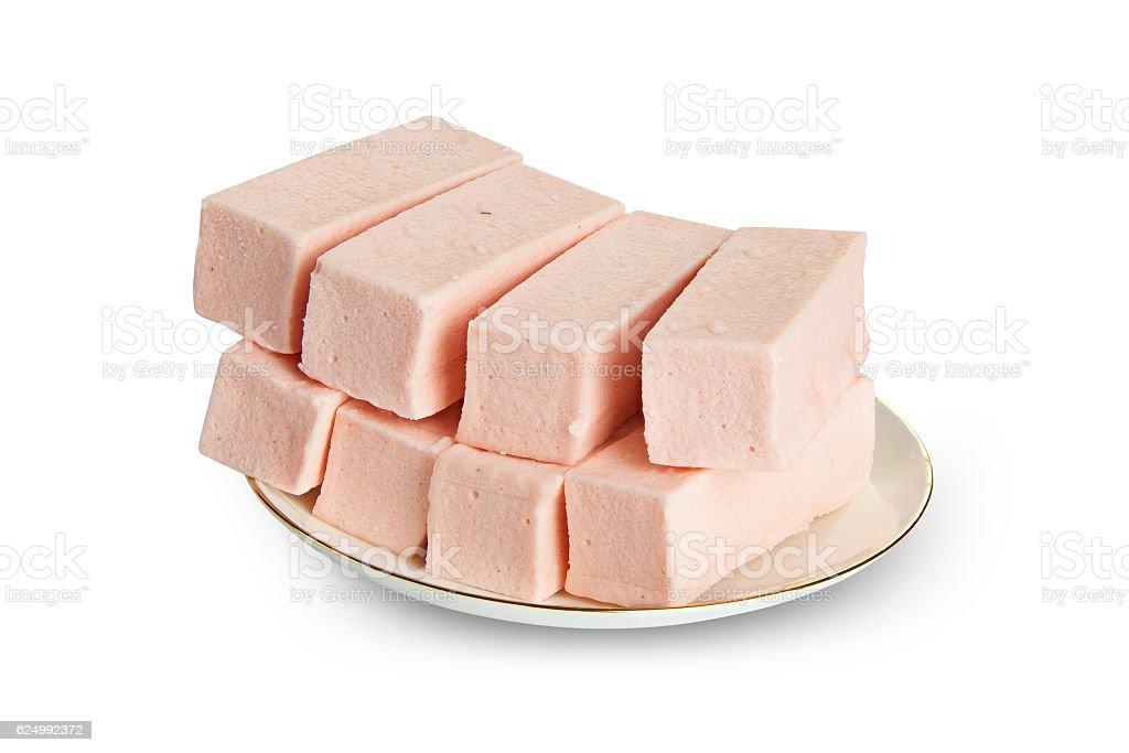 Delicious  strawberry paste  on plate on white stock photo