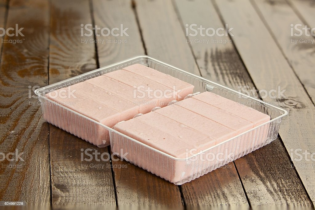 Delicious  strawberry paste  on plate on wooden stock photo