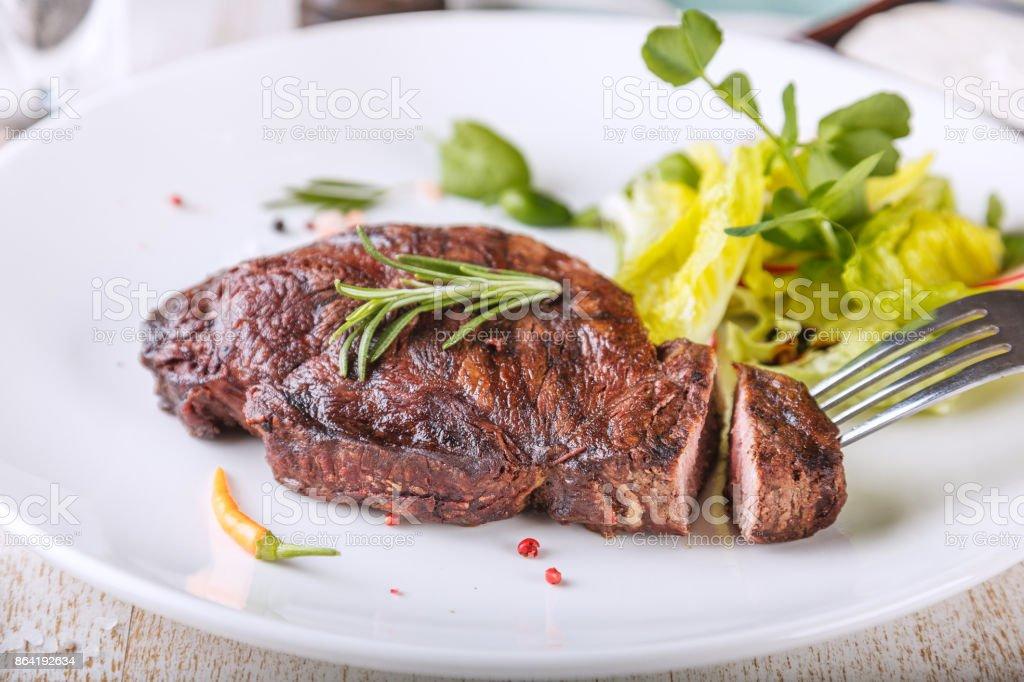 Delicious Striploin steak royalty-free stock photo