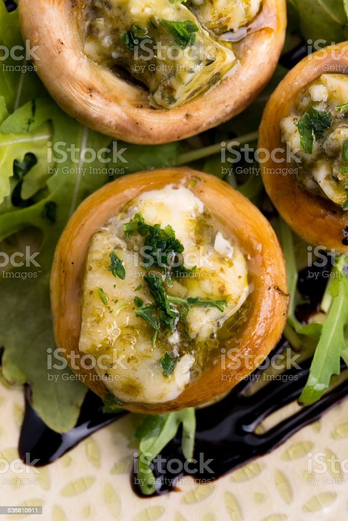 Delicious stuffed mushrooms with cheese and pesto stock photo