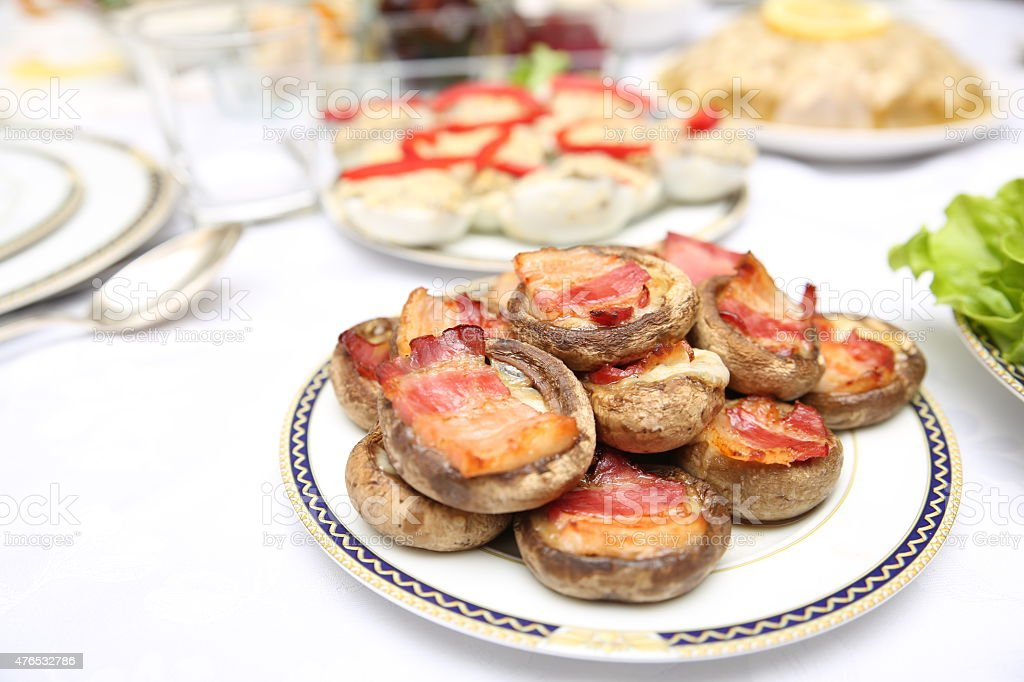 Delicious stuffed mushrooms with meat and cheese stock photo