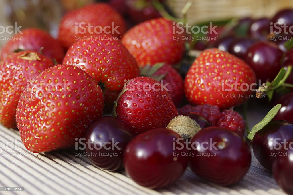 Delicious summer berries: cherry, strawberry royalty-free stock photo