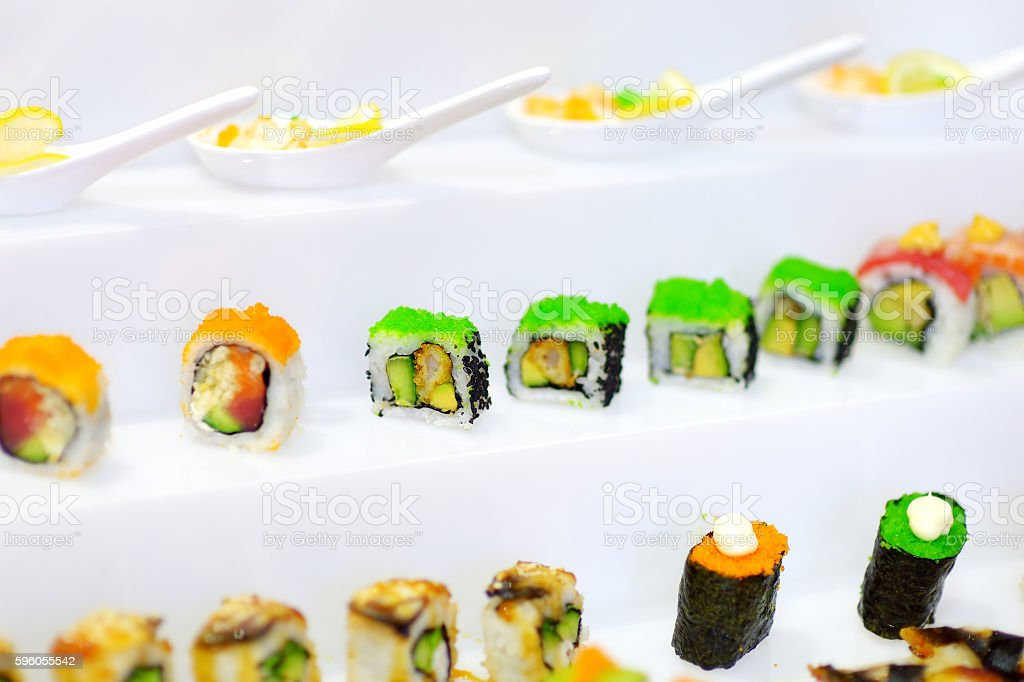 Delicious sushi with avocado topping royalty-free stock photo