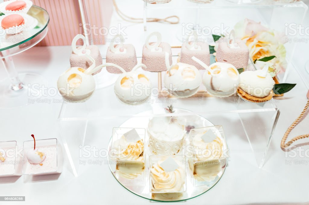 Delicious sweet buffet with cupcakes. Sweet holiday buffet with cupcakes and other desserts. Candy Bar. royalty-free stock photo