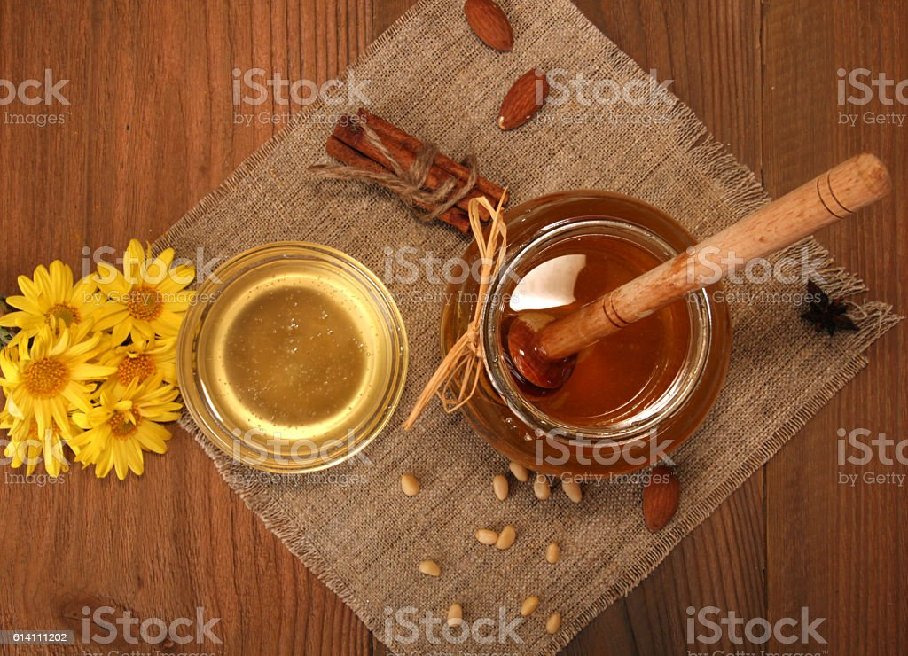 Delicious sweet honey with dipper in glass jar. stock photo