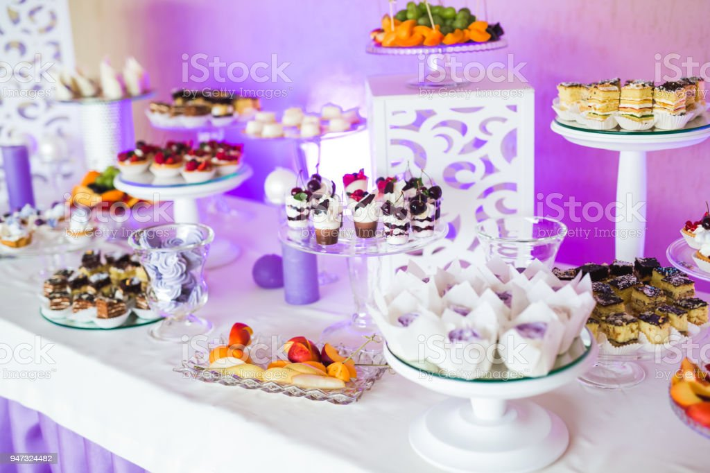 Delicious sweets on wedding candy buffet with desserts, cupcakes stock photo