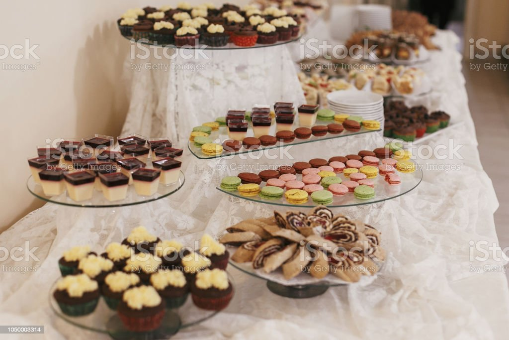 Delicious Table With Desserts And Macarons At Wedding Reception In Restaurant Candy Bar Luxury Wedding Catering Stock Photo Download Image Now Istock
