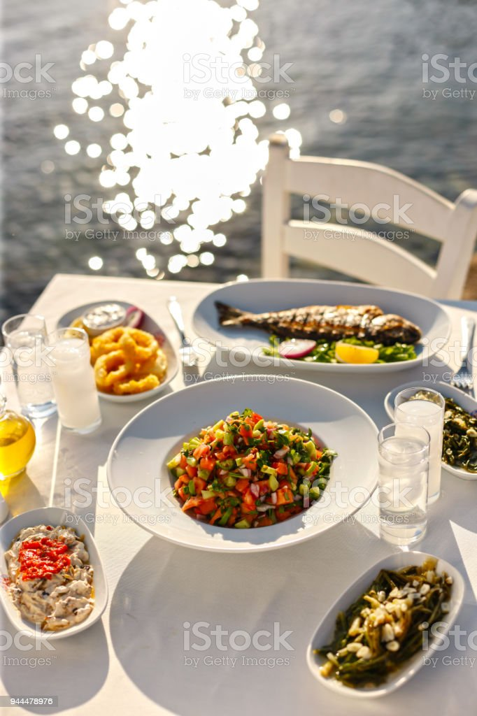 Delicious Table with Sea Food Dishes, Raki or Ouzo and Appetizers - foto stock