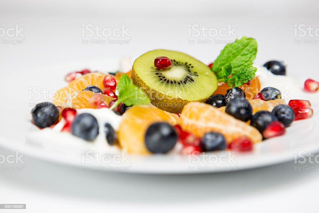 Delicious tasty exoctic fruit salad with white background