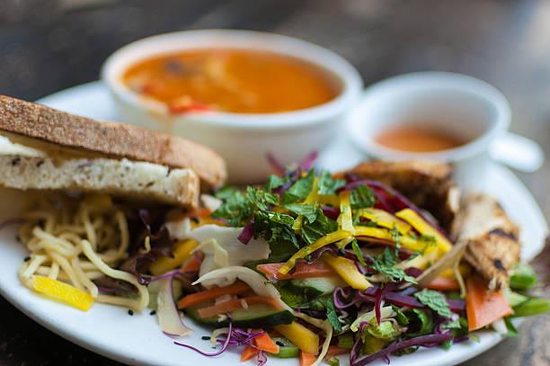 Delicious tortilla soup and mango salad stock photo