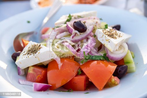 Greek tastes are one of the best traditional mediterranean meals. This is Greek Salad, ingredients; shrimp, tomatoes, feta sheese, olive oil and ouzo.
