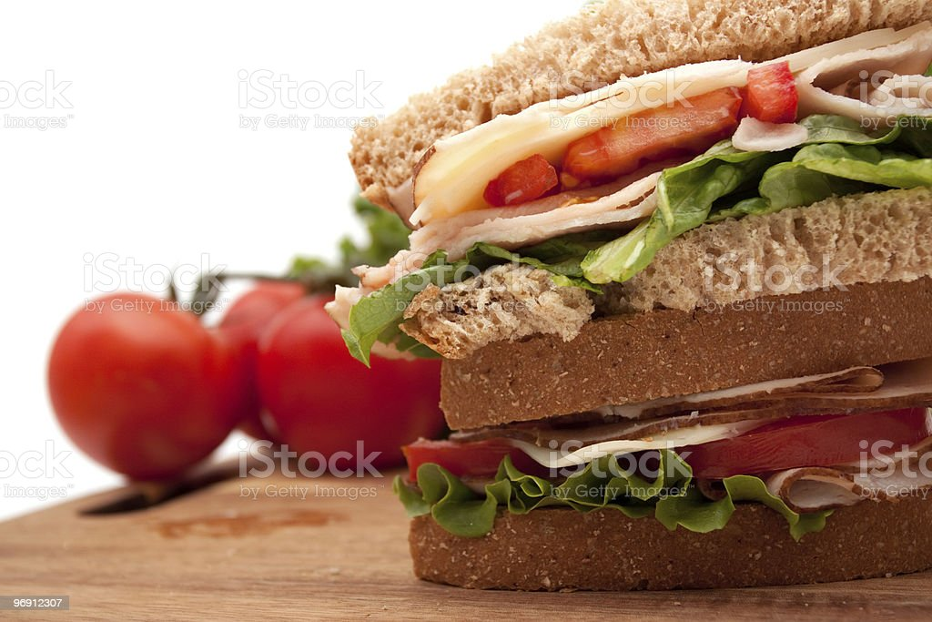 Delicious turkey sandwich on wheat bread royalty-free stock photo