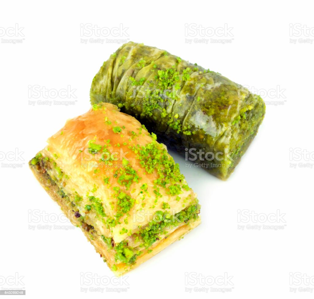 Delicious Turkish baklava and sarma with green pistachio nuts. stock photo