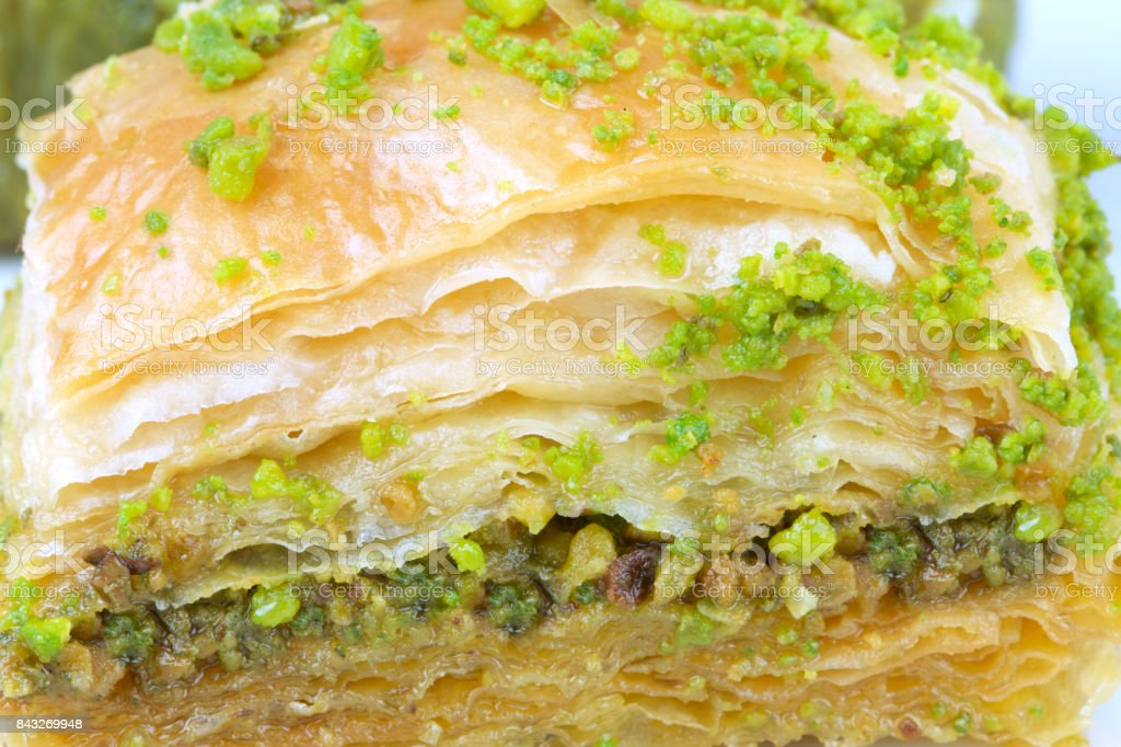 Delicious Turkish baklava and  with green pistachio nuts. stock photo