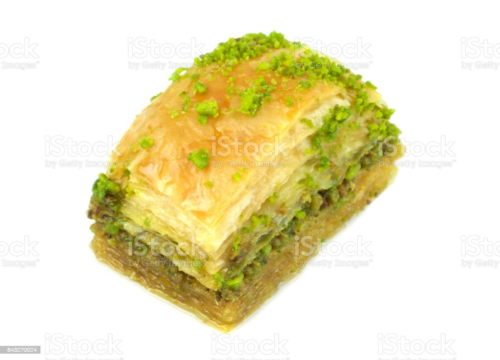 Delicious Turkish baklava with green pistachio nuts. stock photo