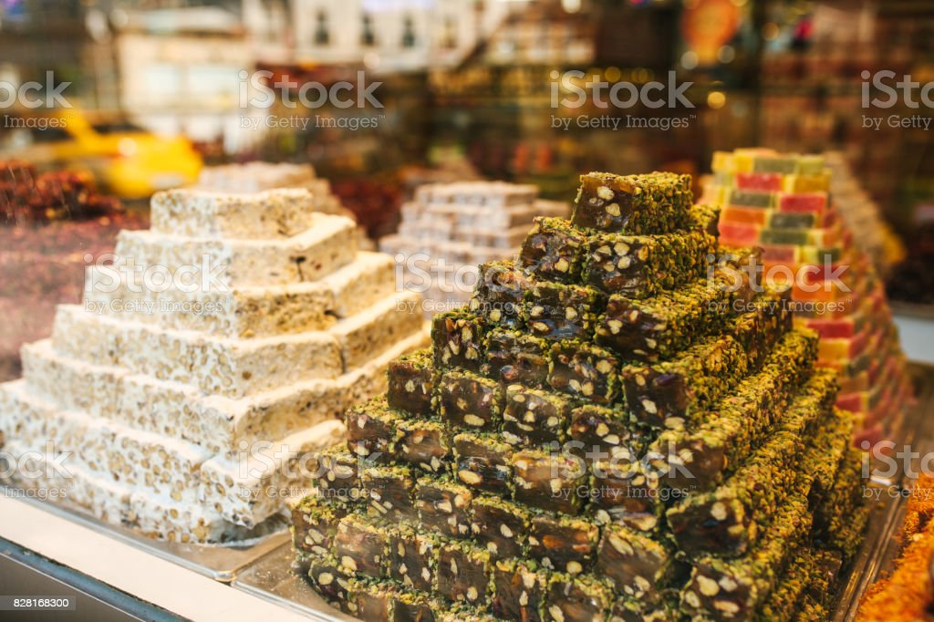 Delicious turkish delight pyramids on display in confectionery shop in Istanbul, Turkey. stock photo