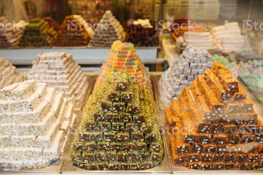 Delicious turkish delight pyramids on display in confectionery shop in Istanbul, Turkey. View through the shop window. stock photo