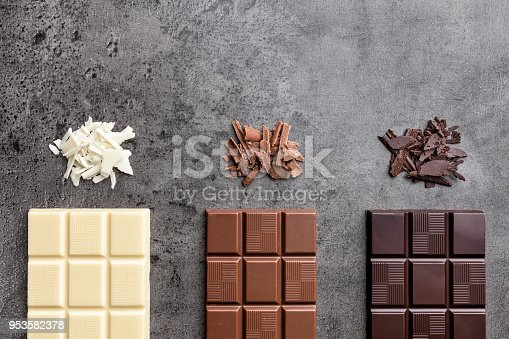 istock Delicious variety of chocolate on rustic background 953582378