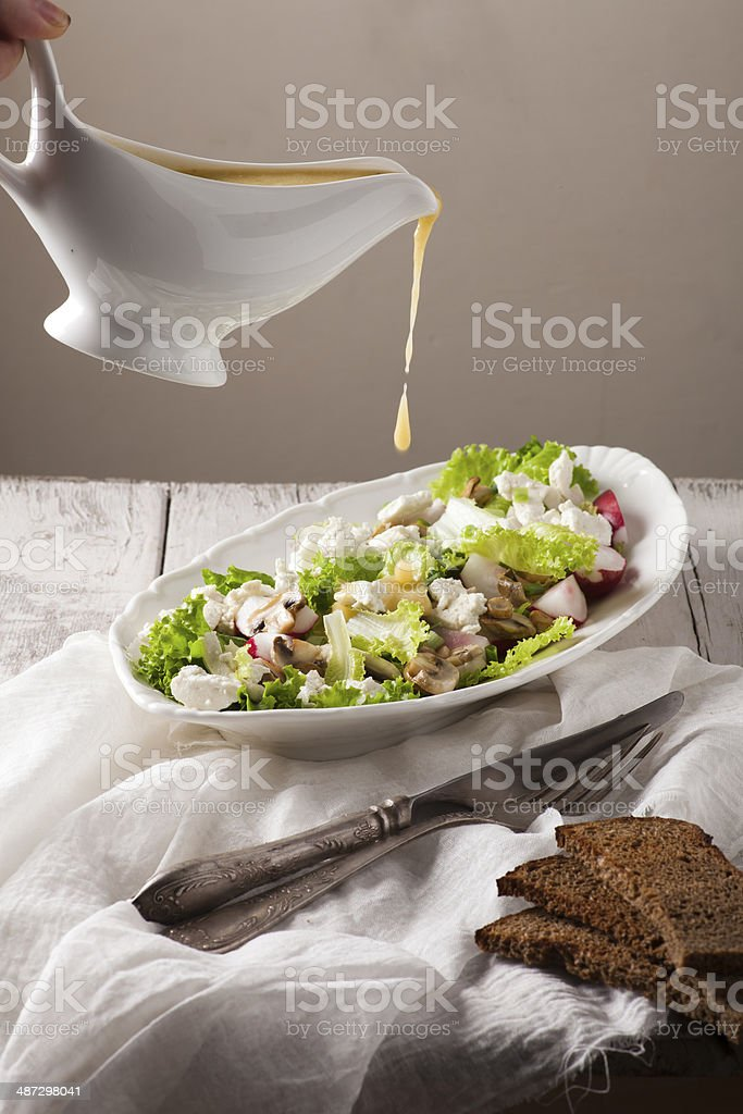 Delicious vegetable salad with cheese and mushrooms stock photo