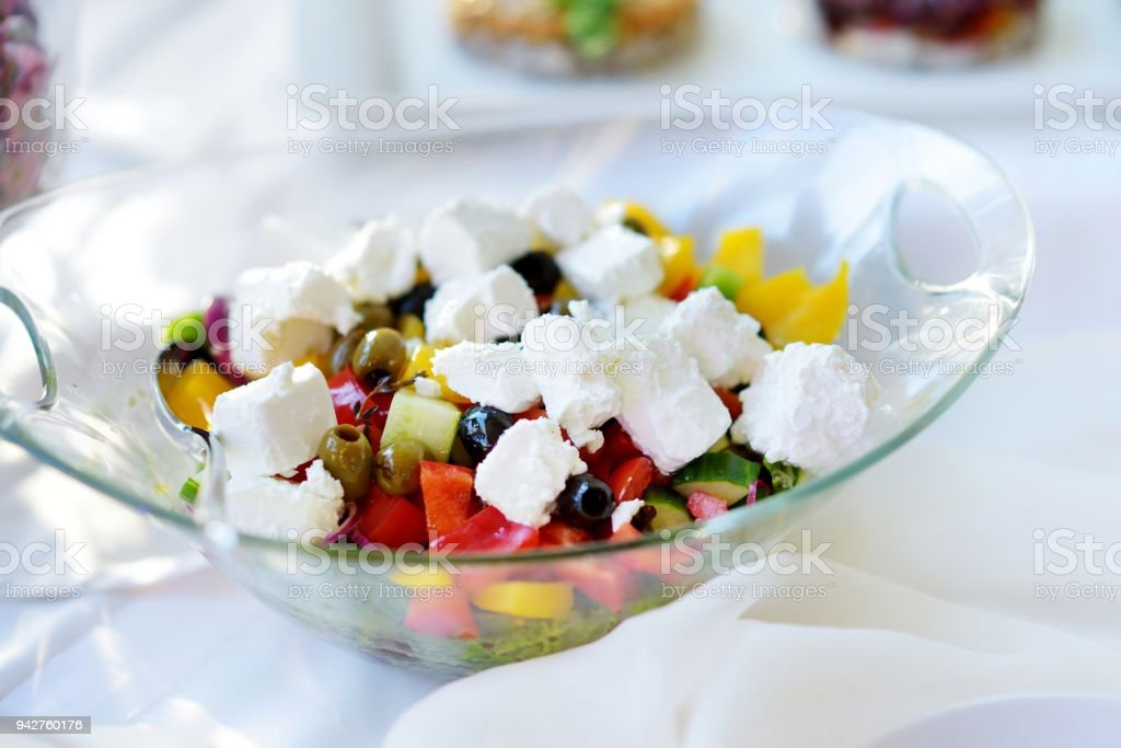 Delicious vegetables and goat cheese salad served on a party or wedding reception stock photo