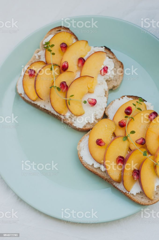 Delicious vegetarian summer toast with peach and cream cheese royalty-free stock photo