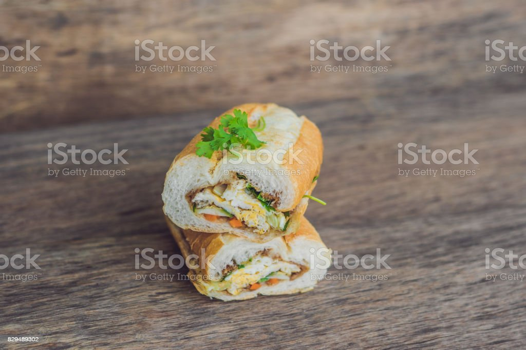 A delicious Vietnamese Bahn Mi sandwich on a wooden background stock photo