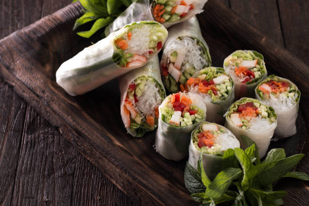 Delicious vietnamese spring roll with vegetable on dark background ,healthy food stock photo