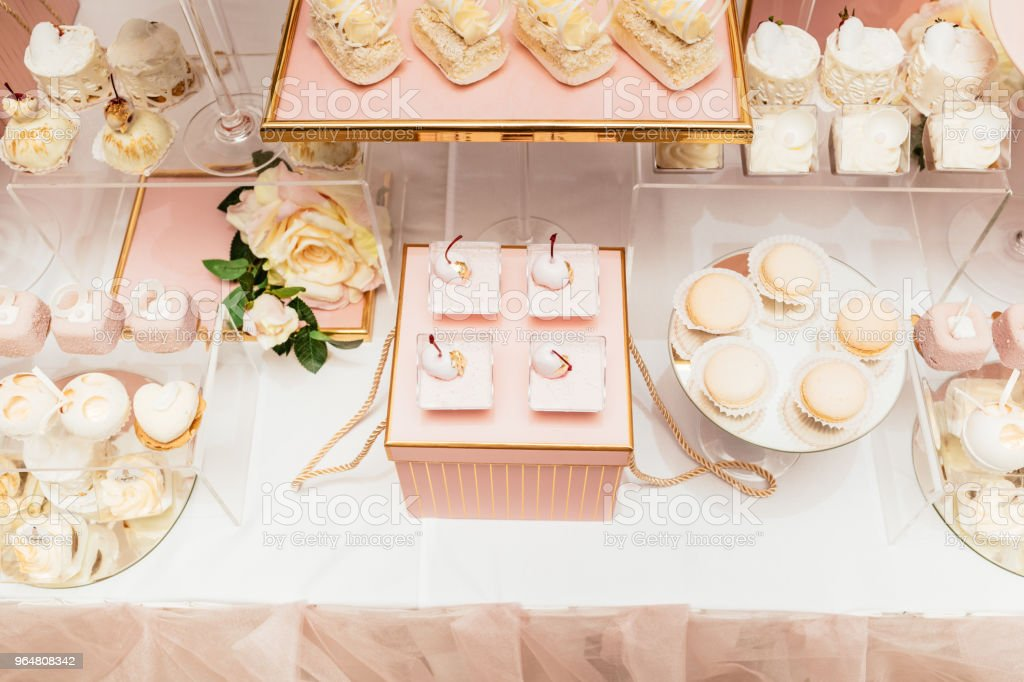 Delicious wedding reception candy bar dessert table full with cakes and sweets royalty-free stock photo