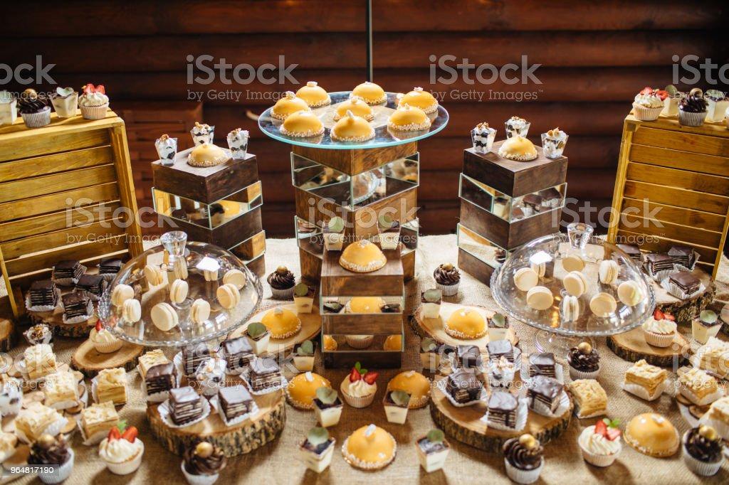 Delicious wedding reception candy bar dessert table royalty-free stock photo