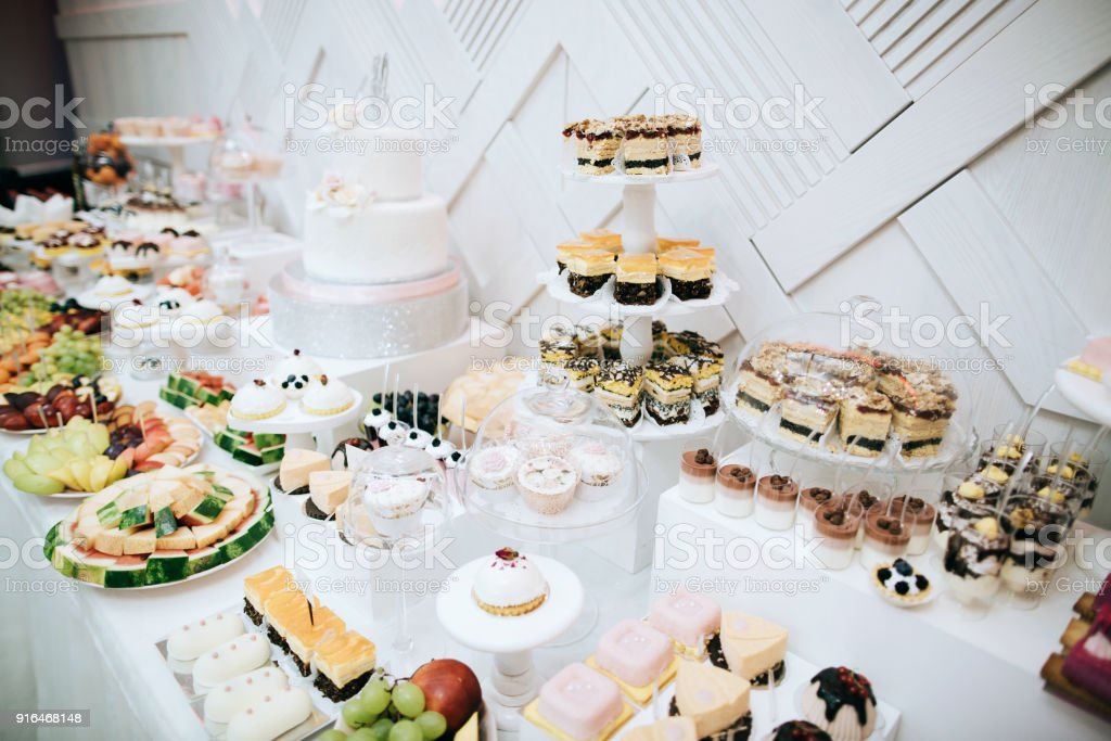 Delicious White Wedding Reception Candy Bar Dessert Table Stock