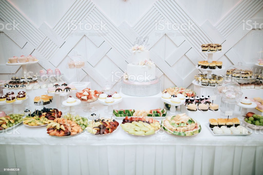 Delicious White Wedding Reception Candy Bar Dessert Table Stock