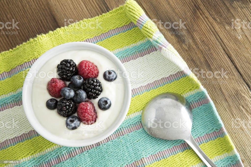 Delicious yogurt and fresh berries for breakfast stock photo