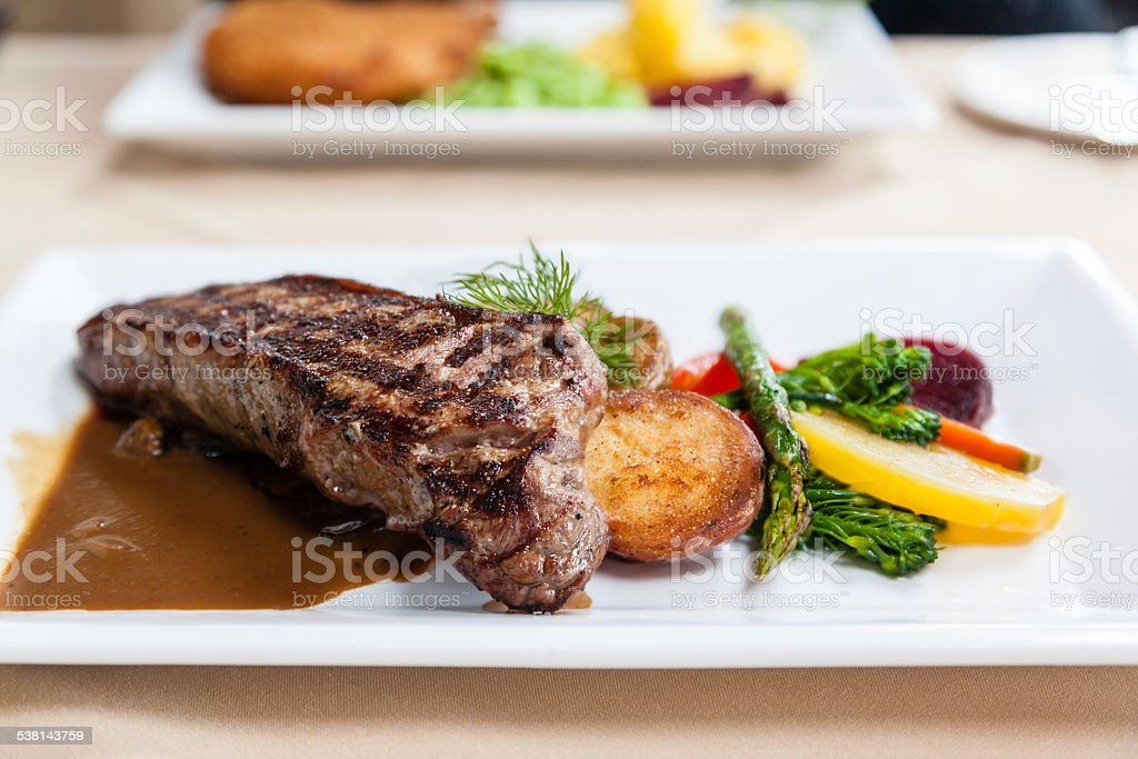 Deliciously Grilled Strip Loin Beef Steak stock photo