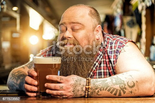 istock Delight bearded male drinking beverage in pub 677523552
