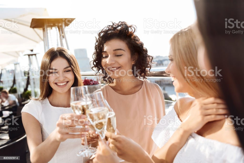 Delighted attractive women cheering with champagne stock photo