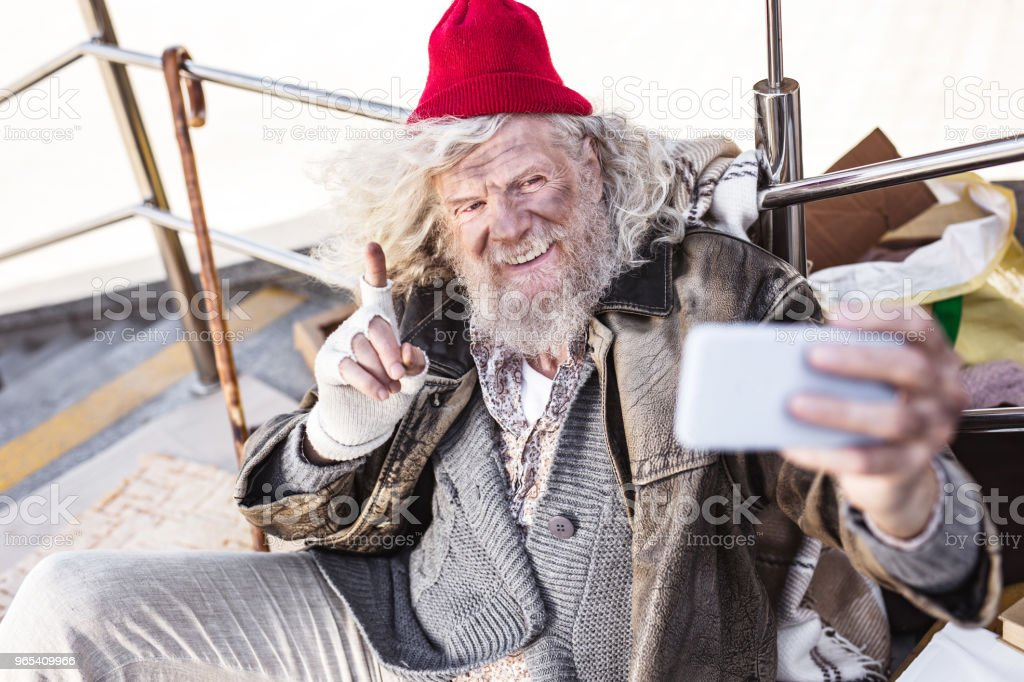Delighted bearded man taking a selfie royalty-free stock photo