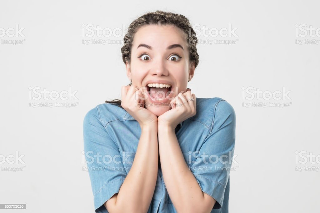 Delighted caucasian woman opening mouth in surprise. stock photo